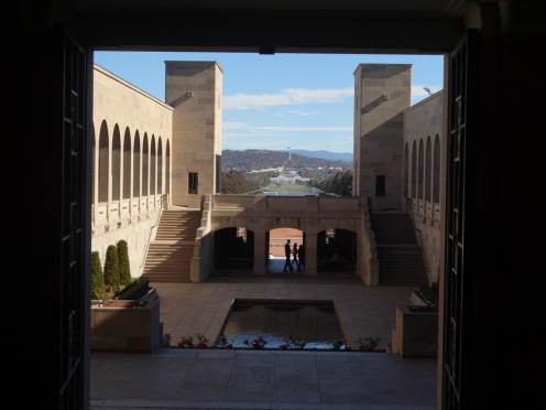 Looking back towards Parliament House down ANZAC parade from inside the Australian War Memorial
