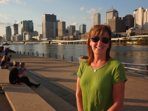 Gail on the Southbank with the river and CBD in the background.