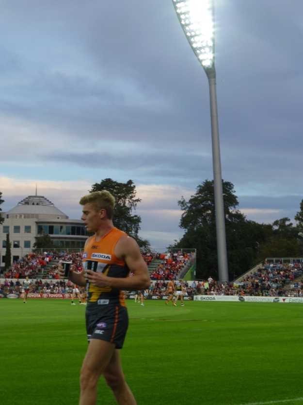 A GWS substitute waits on the sidelines to join the action