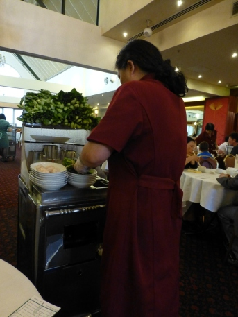 One of the Yum Cha waitresses doing her stuff