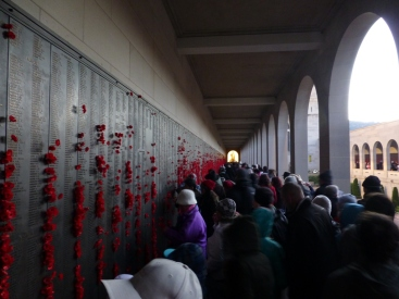 People paying their respects inside the Roll of Honour.