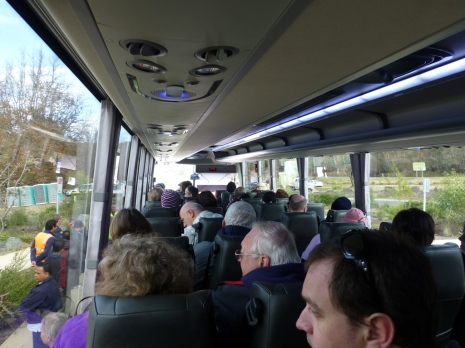 On board the coach up to the dam.