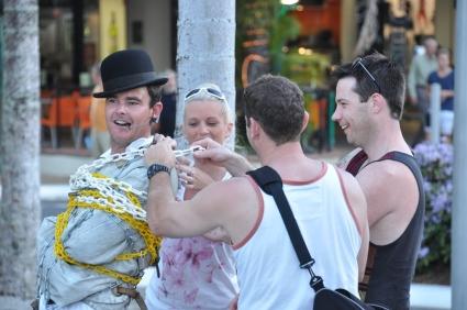 Street entertainer doing his Houdini stuff.