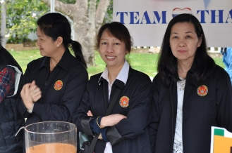 Members of embassy staff serving iced tea