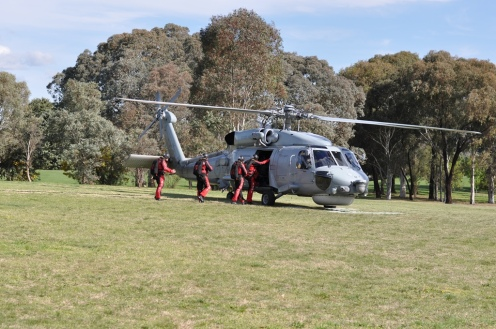 The Red Berets climb aboard the helicopter for their lift up above.