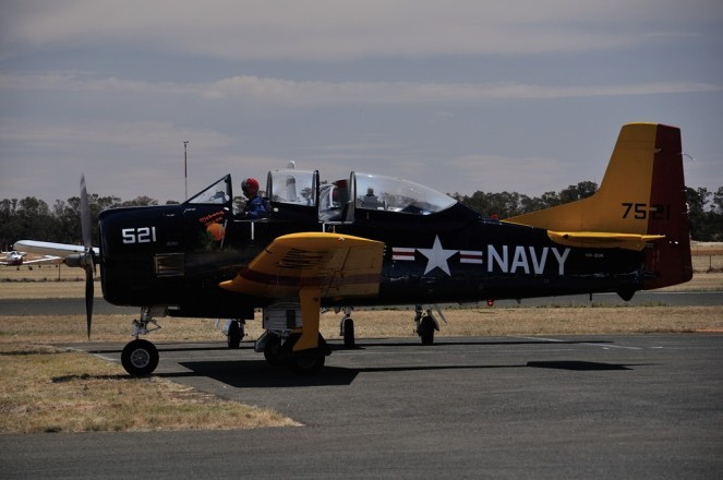 The first of the T-28 Trojans sets off down the runway.