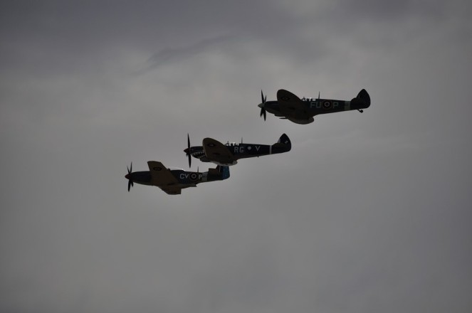 The two Spitfires and the Mustang make one final pass.
