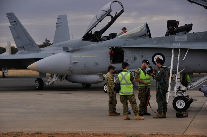 the RAAF boys discuss todays flight.