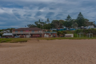 Looking at Narooma SLSC with the campsite behind
