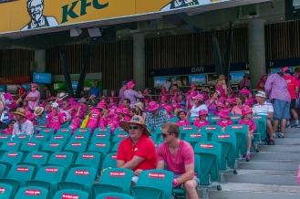 Schoolkids dressed in pink amongst the crowd