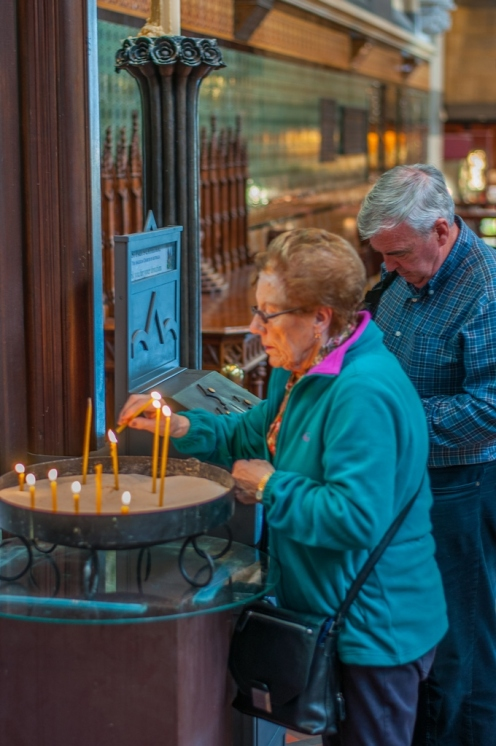 Mum lights a candle for her brother, Eddie
