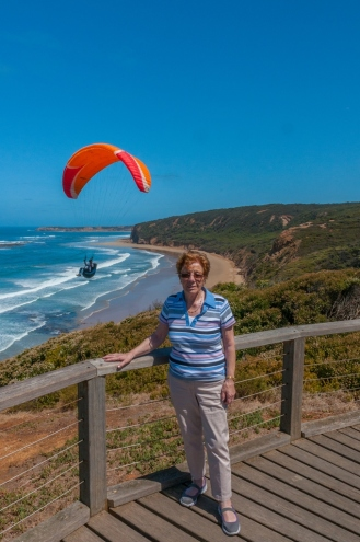 Great shot of the mum, beach and paraglider.