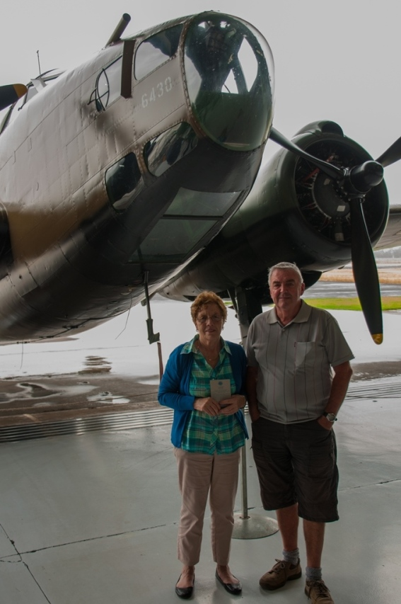 Mother and father in front of the Lockheed Hudson