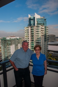 Mother & father pose for one last picture at the apartment.