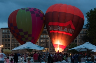 The first balloons go up.