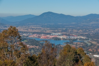 Lake Tuggeranong in the foreground with Mt. Tennent in the background. The large white building in the centre of picture is where I work.