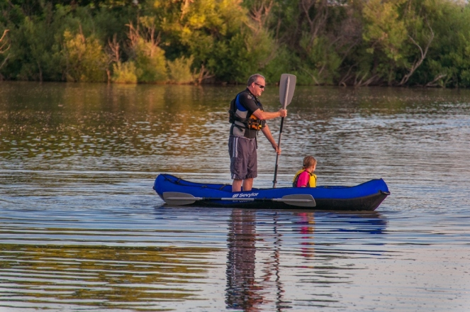 Andrew and Dylan try SUPing on their canoe
