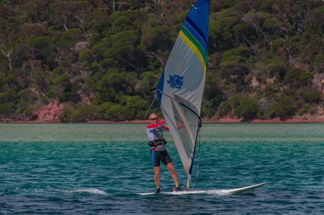 Glenn speeds along on his windsurfer